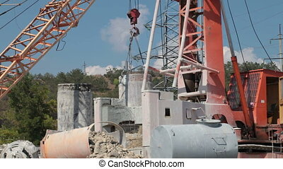 Crane and drilling rig on construction site