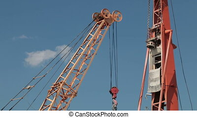Drilling rig and crane at a construction site - Equipment at...