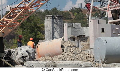Builders working at the construction site - Builders working...