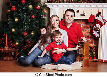 Happy family in Front Of Christmas Tree
