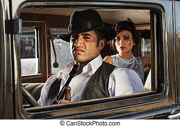 Sneering 1920s Gangster Driver - Sneering 1920s vintage...