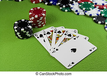 Royal flush in poker cards, chips table