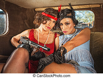 Retro Gangster Women in Car - Pair of pretty 1920s female...