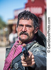 Stern Cowboy Points gun - Serious Cowboy Points Gun at You