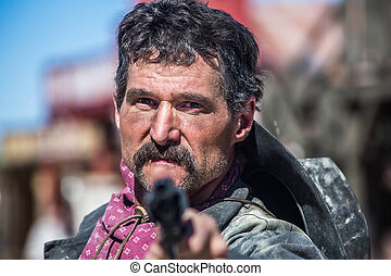 Serious Cowboy With Pistol - Serious Cowboy Points Gun at...