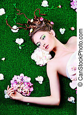 surrounded by flowers - Beautiful relaxed woman lying on a...