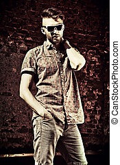 handsome man - Fashionable handsome young man posing outdoor...