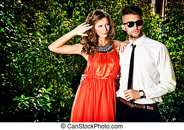 fashion pair - Beautiful fashionable couple standing...