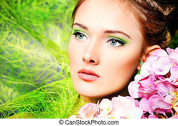 complexion - Portrait of a beautiful girl with flowers...