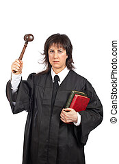 Angry female judge holding the gavel and books Shallow depth...