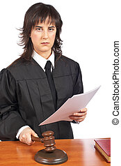 Reading the verdict - A female judge in a courtroom reading...