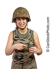 Holding a hand grenade - A beautiful soldier girl holding a...