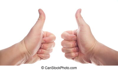 Thumbs up - Two hands appearing on white background and...