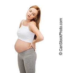 tired future mother supporting her back - pregnancy,...