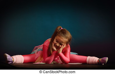 little ballerina girl exercising in studio