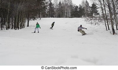 Three Snowboarders - Slow-motion of group of snowboarders...