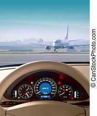 wheel - Wheel and dashboard of a car and view of airport