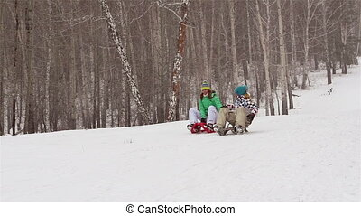 Two On Sleds - Girl and guy on sleds enjoying winter pastime