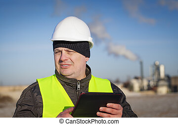 Engineer with tablet PC near the factory episode 1