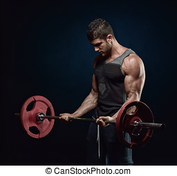 athletic young man portrait - athletic young man lifting...