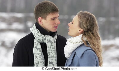 Winter Talk - Amorous couple talking outside on a winter day