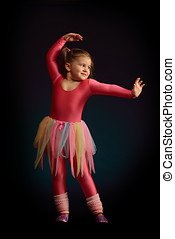 little ballerina girl exercising in studio