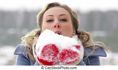 Winter Lady - Slow-motion of a charming winter lady blowing...