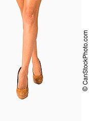 Crossed legs - Female legs crossed in an isolate studio shot