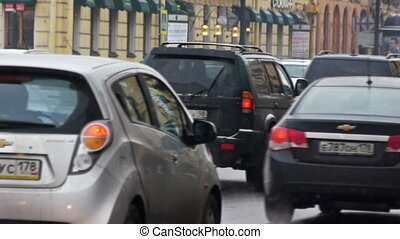 City road crowded with many cars at winter day