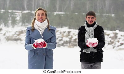 Playing outdoors - Happy valentines throwing handfuls of...