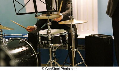 Musician playing the percussion instruments