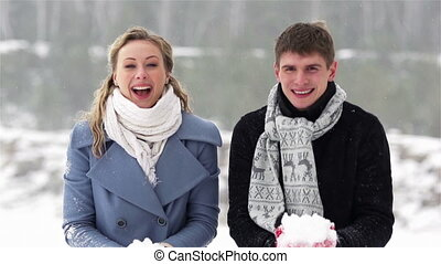 Winter Activity - Cheerful couple enjoying their winter...