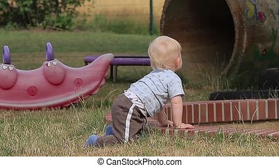 Curious Baby Watching (People) - Baby Playing On Playground