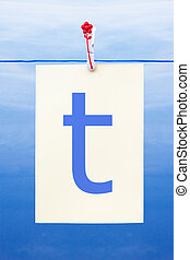 Seamless washing line with paper showing the letter t -...