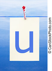 Seamless washing line with paper showing the letter u -...