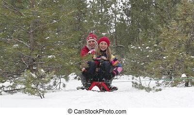 Winter Emotions - Emotional couple enjoying a sledge ride...