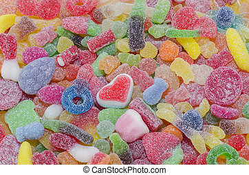 Candy - Colorful candy with a heart-shaped one in the middle...