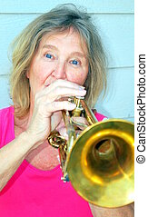 Female trumpet player. - Mature female trumpet player...