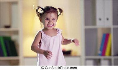 Happy Jumping - Slow-motion of a cheerful little cutie...