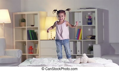 Carefree Child - Slow-motion of a carefree girl jumping on...