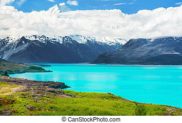 Lake Pukaki - Mighty Mt. Cook is appearing from the clouds...