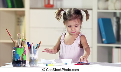 Childish Creativity - Diligent girl developing her...