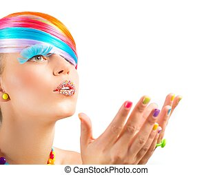 Colorful fashion makeup with rainbow magic accessories