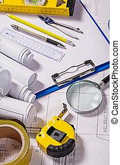 set of architect tools on blueprint