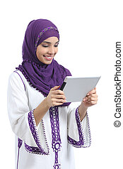 Arab woman reading a tablet reader isolated on a white...