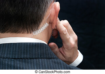 Secret Service Agent Listens To Earpiece, Behind - Close-up...