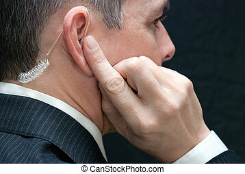 Secret Service Agent Listens To Earpiece, Close Side -...