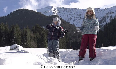 Winter Vacation - Children thrown snowballs on a background...