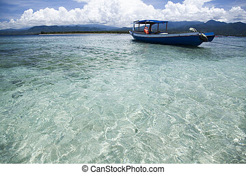Boat on the blue lagoon of Gili Air,Indonesia