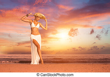 woman on the beach at sunset